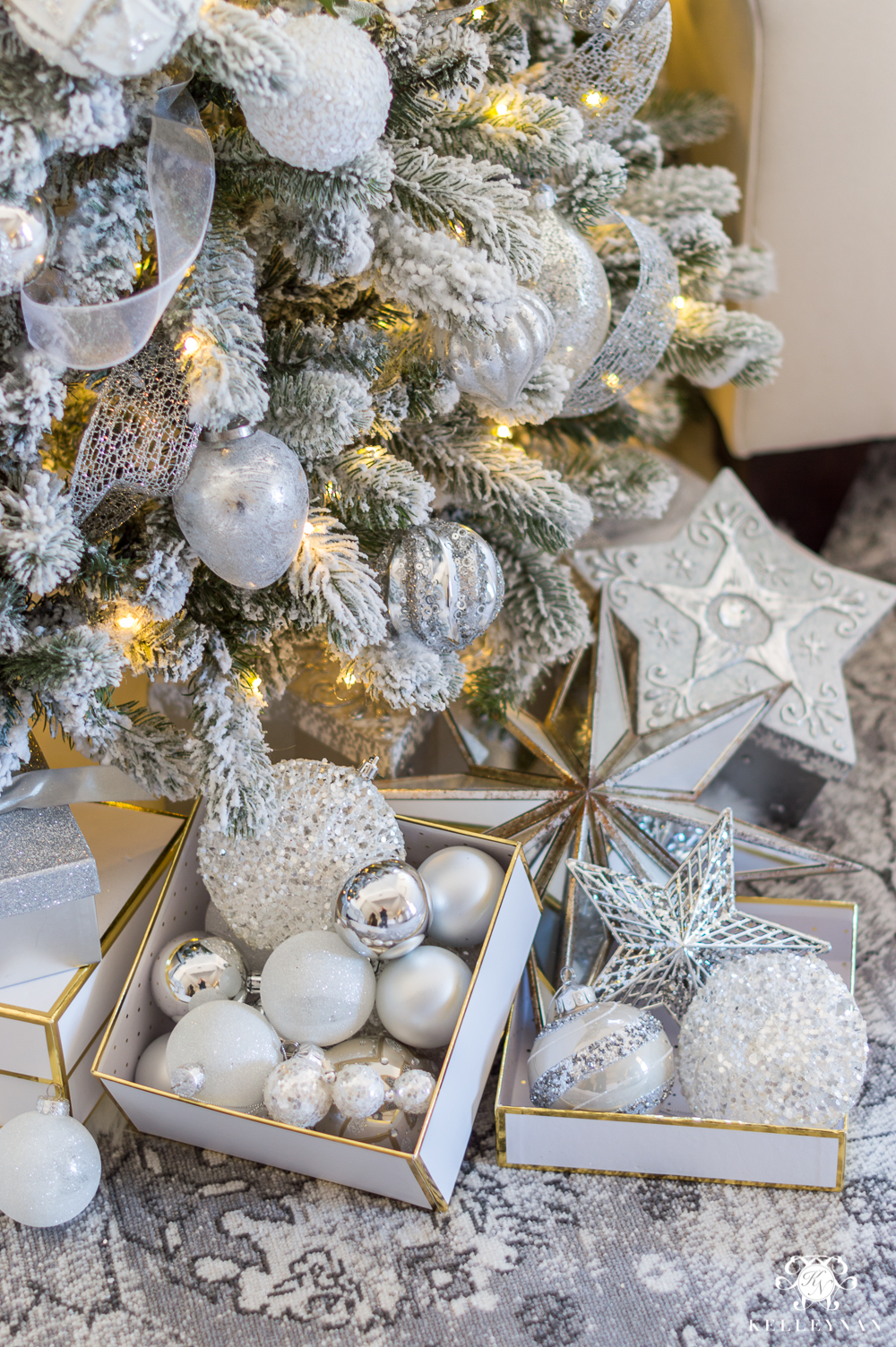 How to style the bottom of a Christmas tree with packages and ornaments