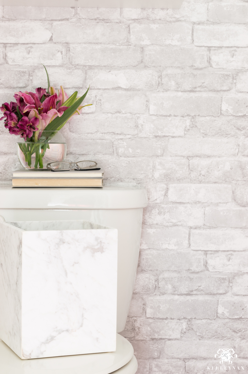 Toilet Room Makeover with white brick temporary wallpaper and marble accents