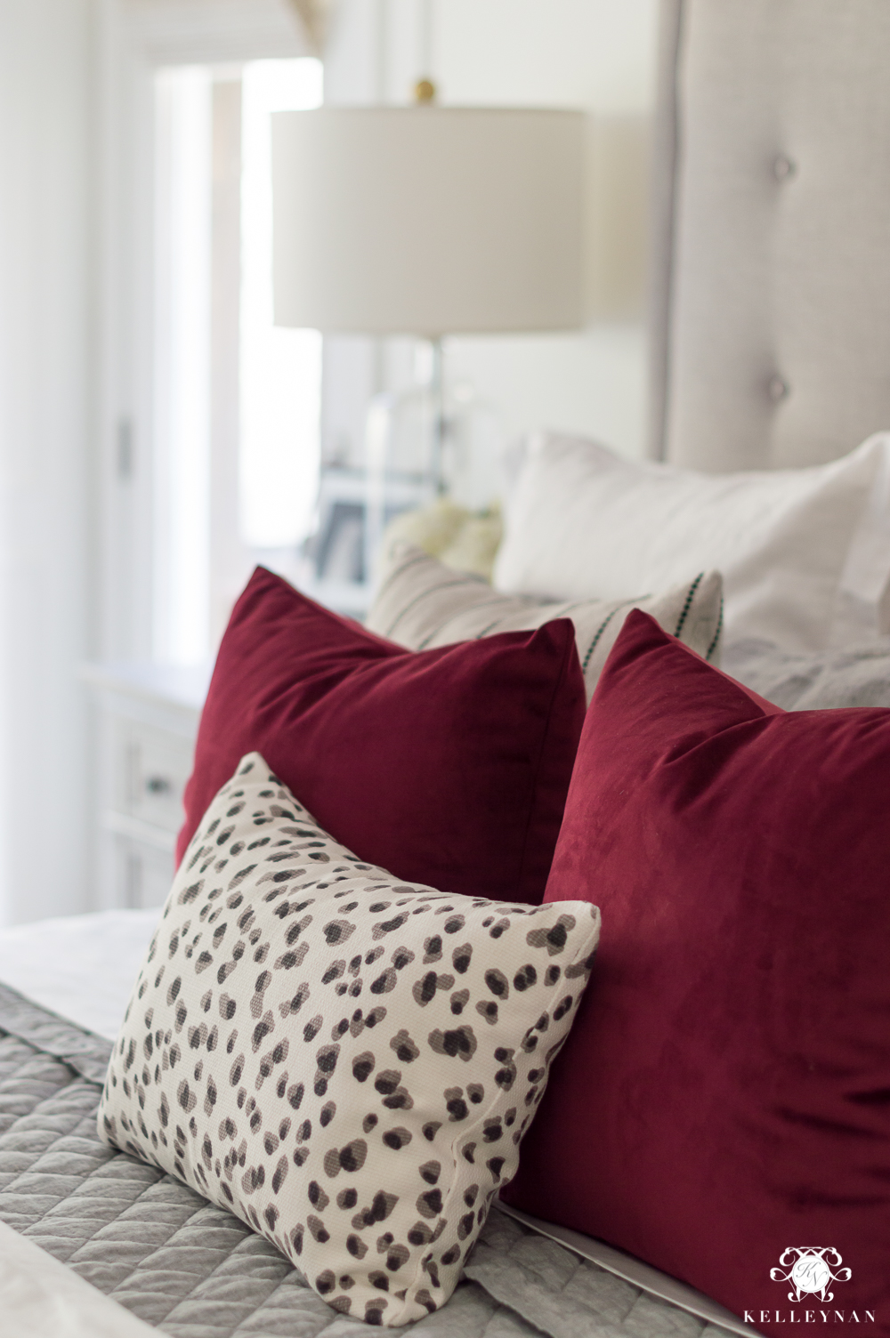 Mixing patterned pillows on the bed with neutral bedding