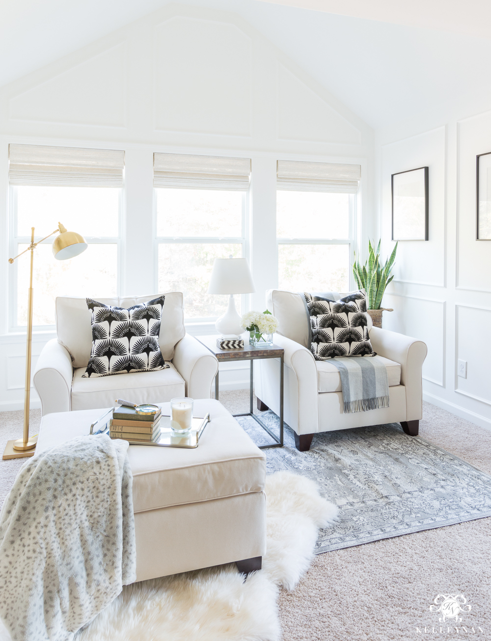 Transitional modern bedroom sitting nook with white chairs