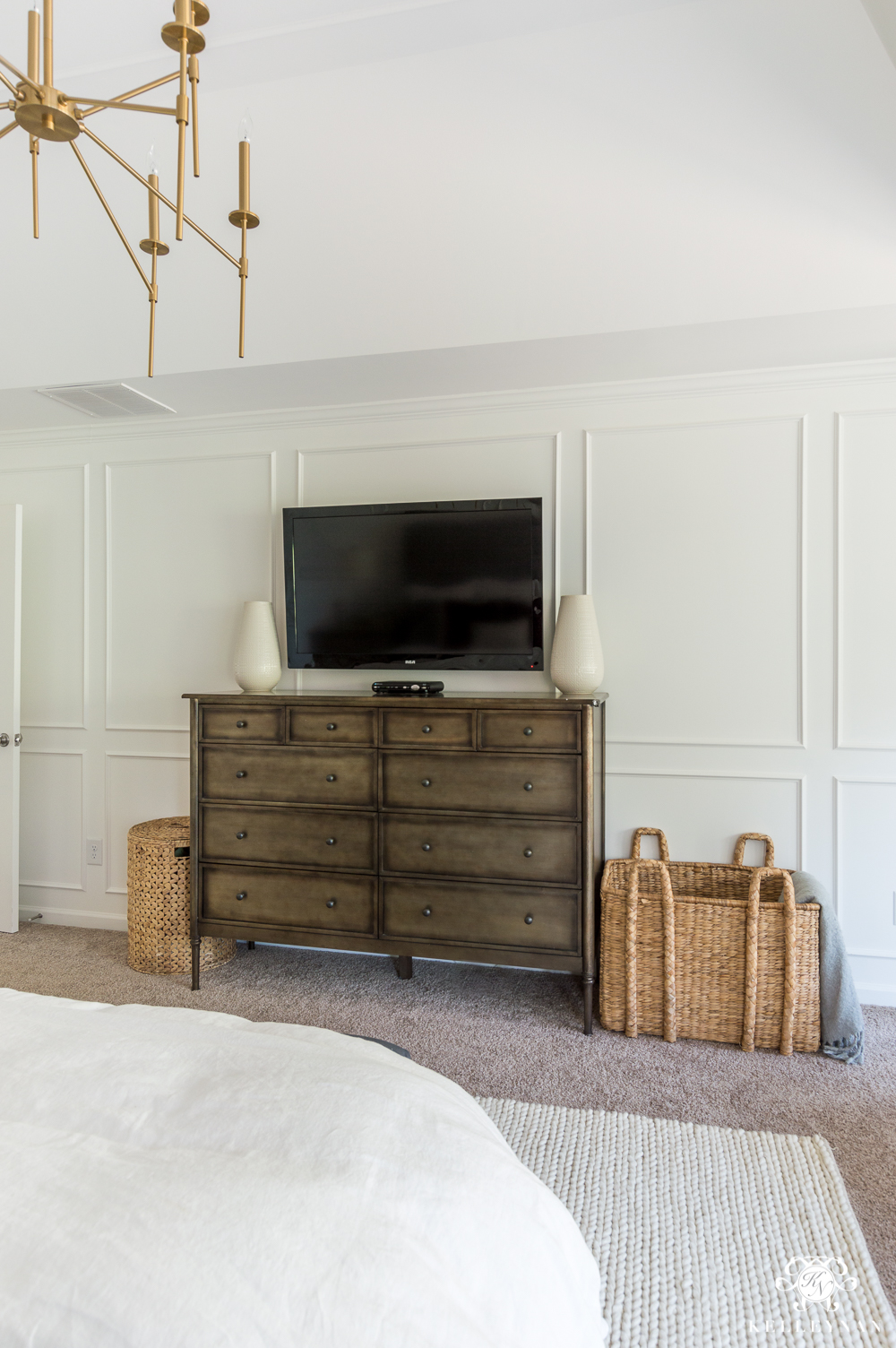 Bedroom TV wall with molding and hanging tv