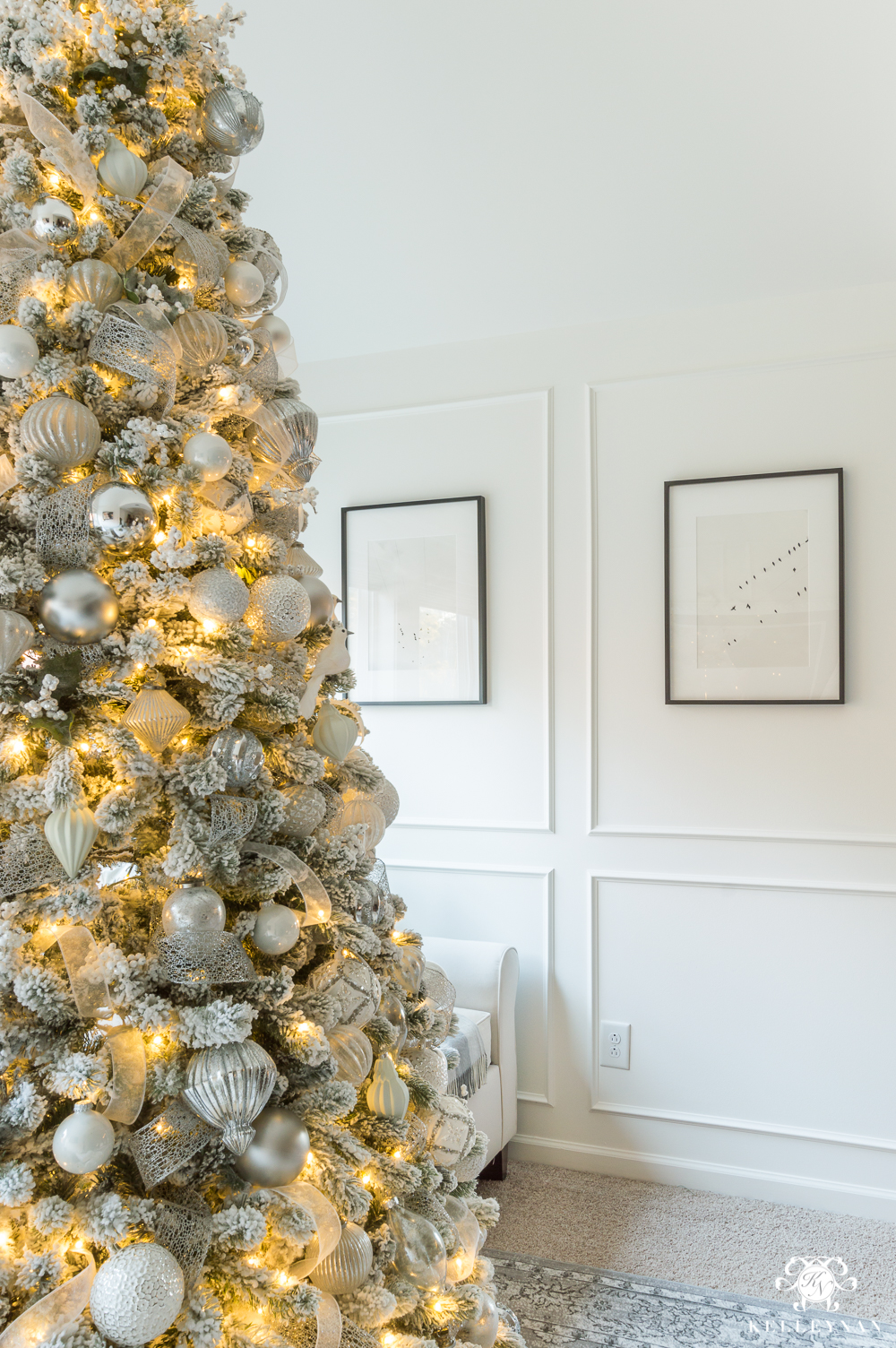 silver and white christmas tree in the bedroom sitting area