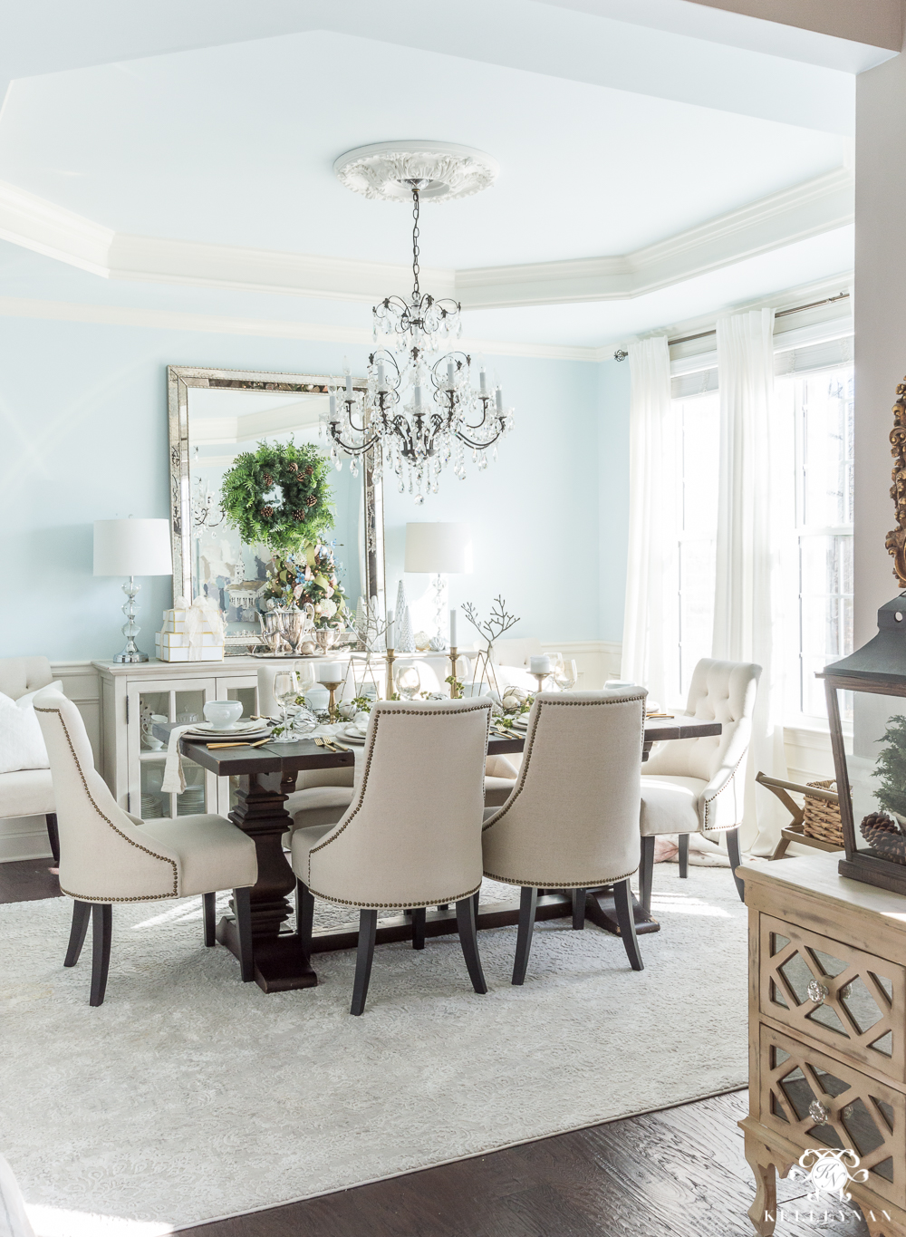 Elegant blue dining room decorated for Christmas