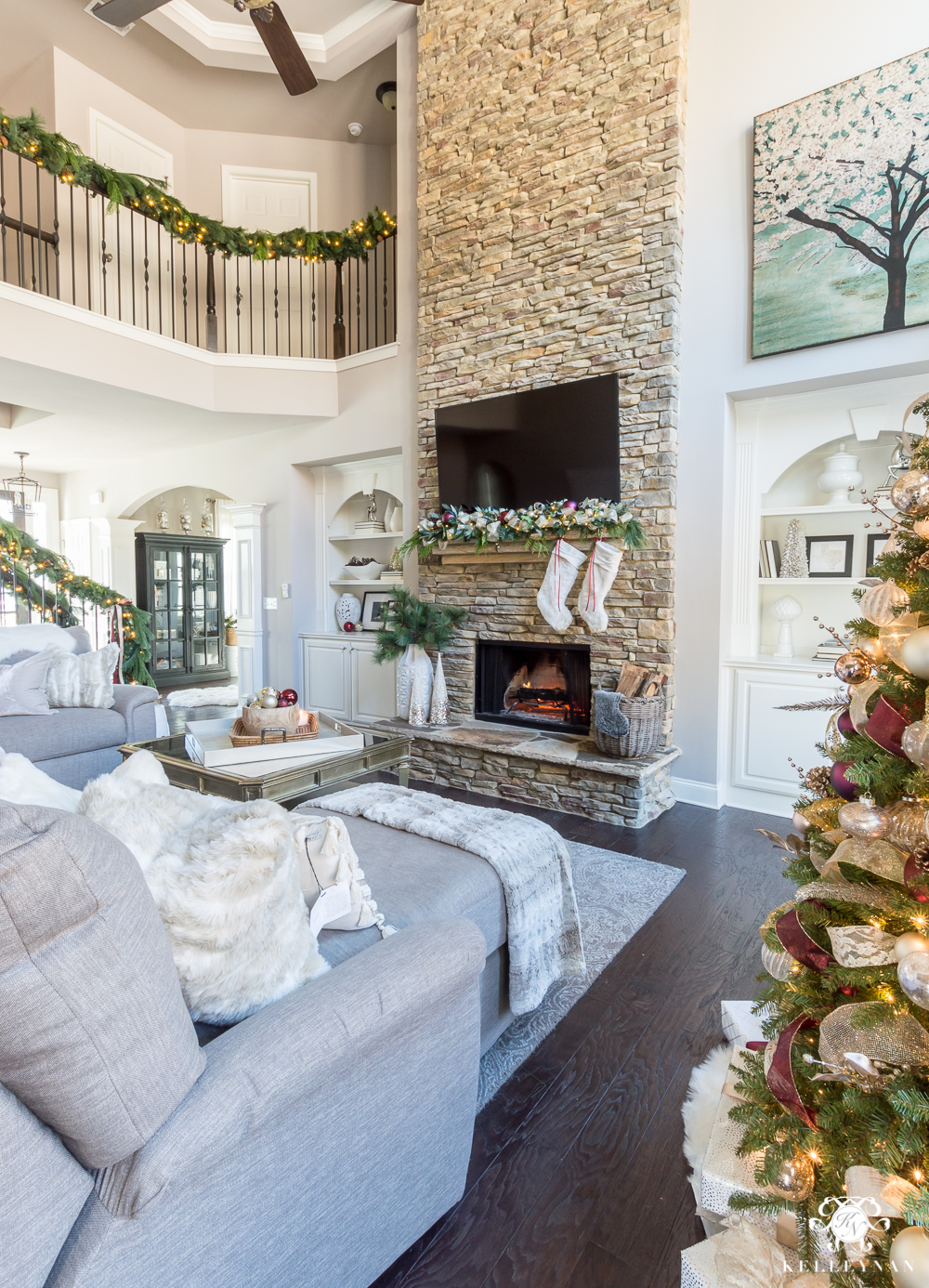 Tall Stacked stone fireplace decorated for Christmas