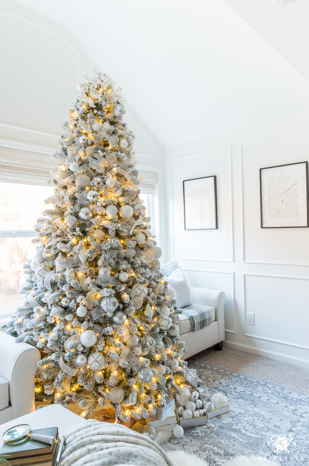 Silver and white flocked Christmas tree in the bedroom