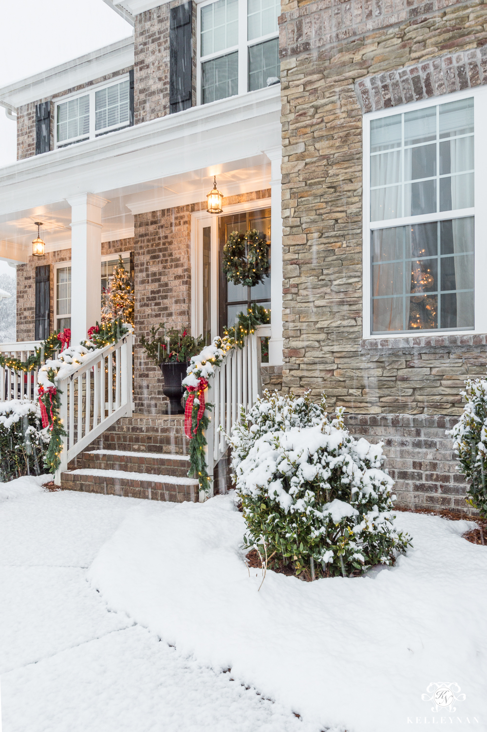 Snowy Front Porch Decorated for Christmas