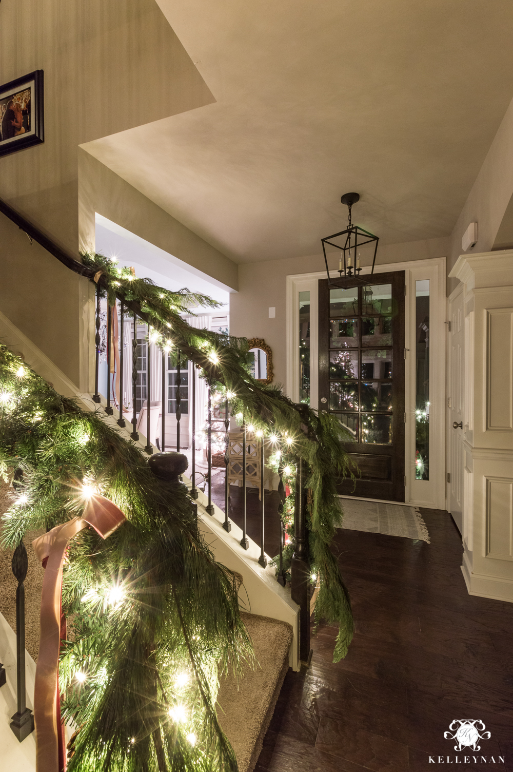 Christmas foyer with bannister garland