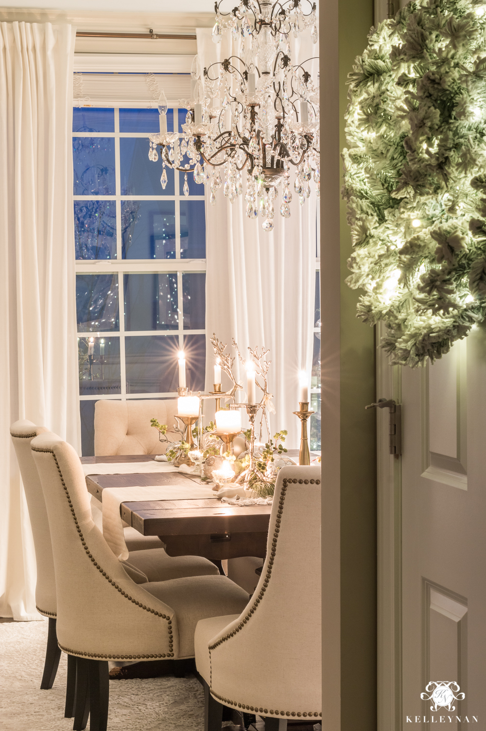 Christmas dining room with candle centerpiece at twilight