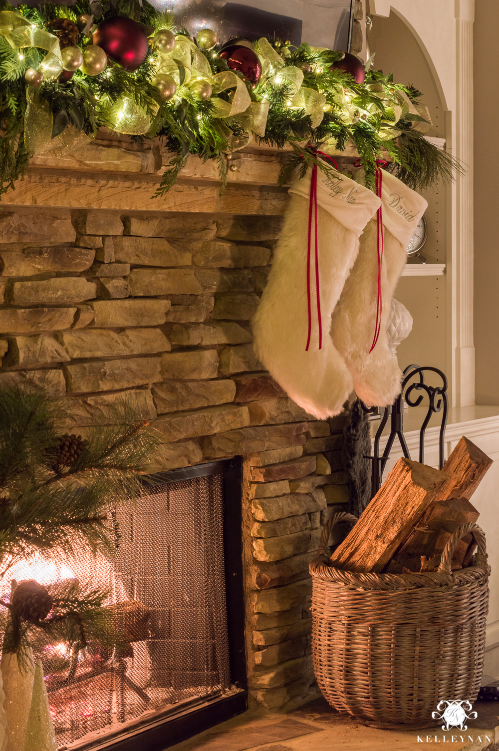 Stockings hung by fireplace with fire at night