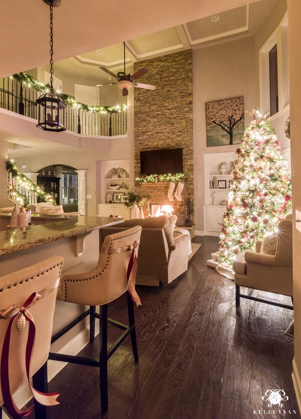 Two story christmas living room with glowing christmas lights
