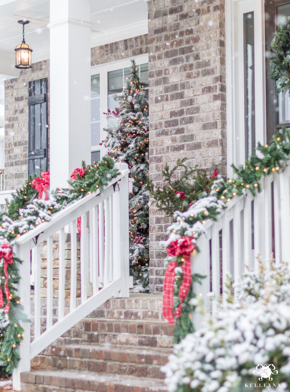 Christmas Porch Decorating Ideas with Flocked Christmas Tree