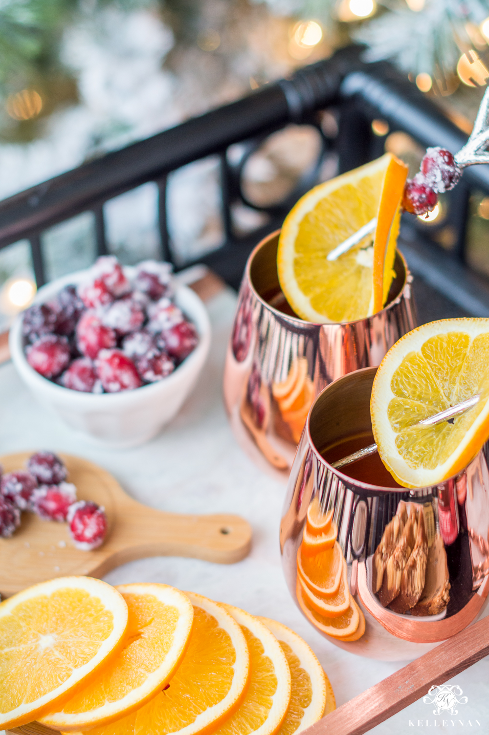 Frosted cranberries with orange slices for christmas drink ideas