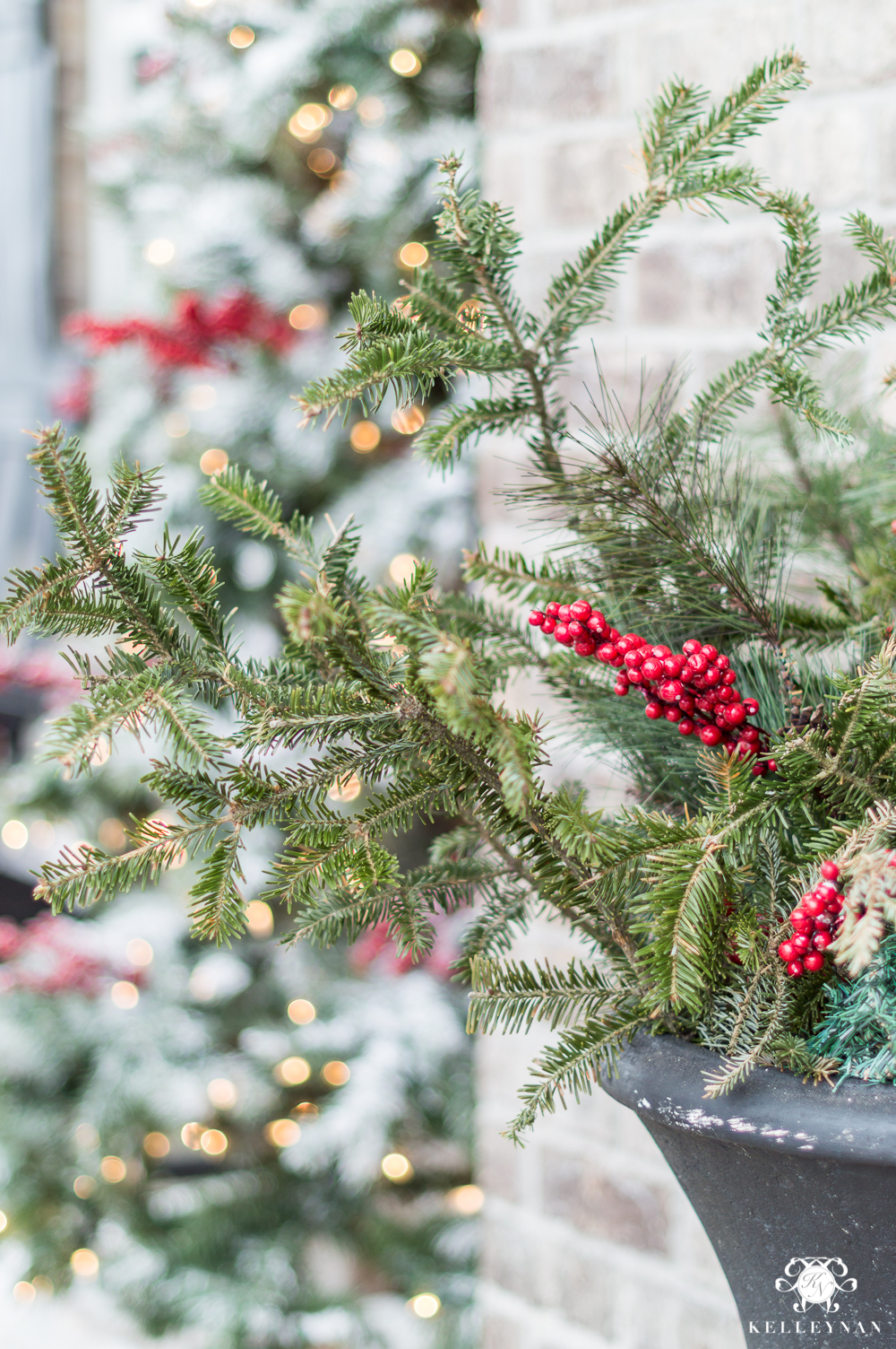 Fresh and Faux greenery in outdoor urns for the holidays