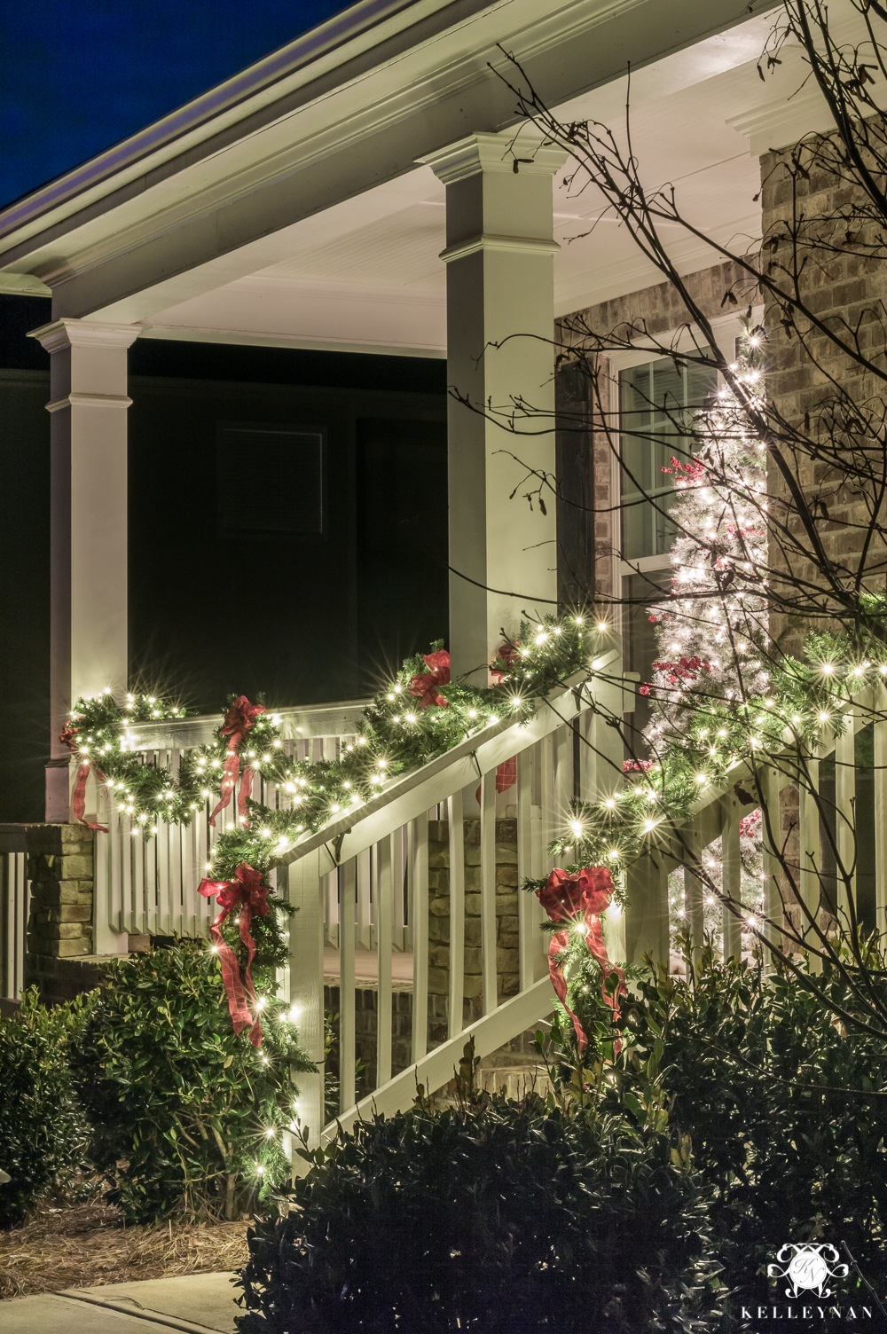 Classic christmas front porch with garland and christmas tree