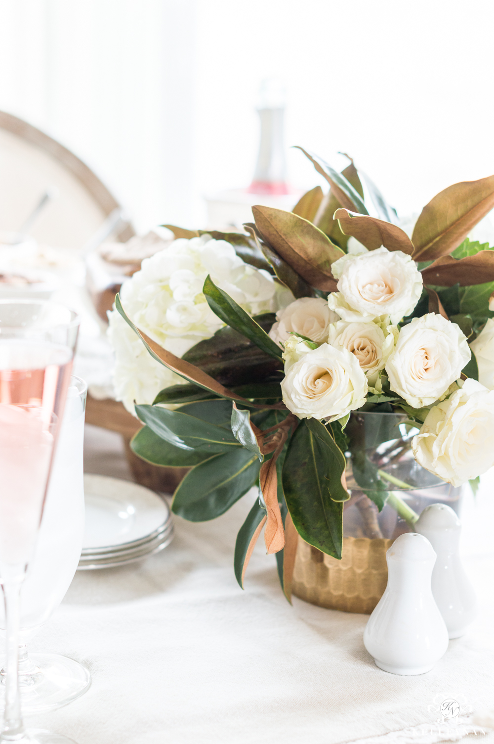 Rose, hydrangea, and Magnolia leaf table centerpiece for a Galentine's luncheon