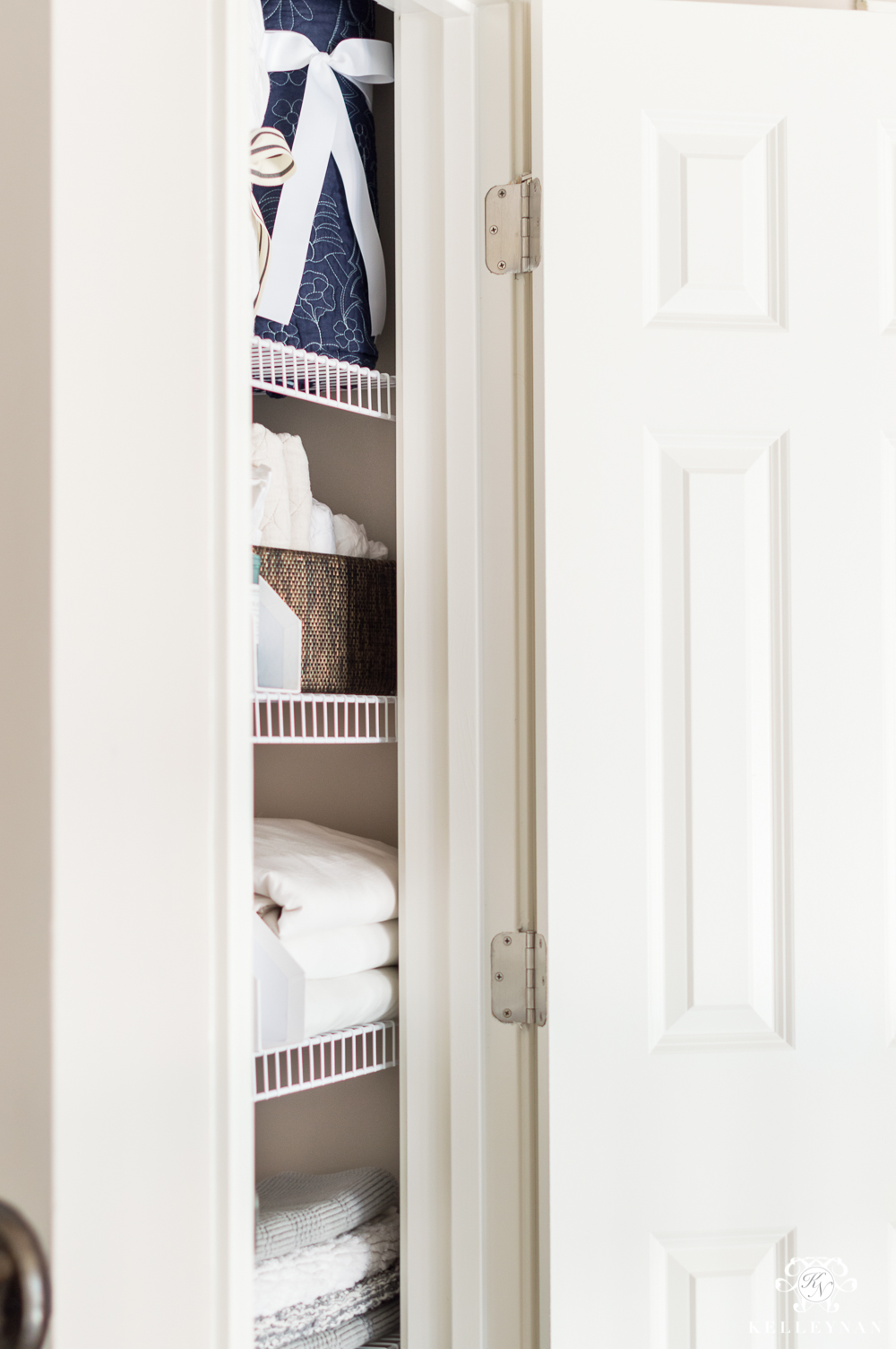 A Small Organized Linen Closet And Ideas To Store Bulky