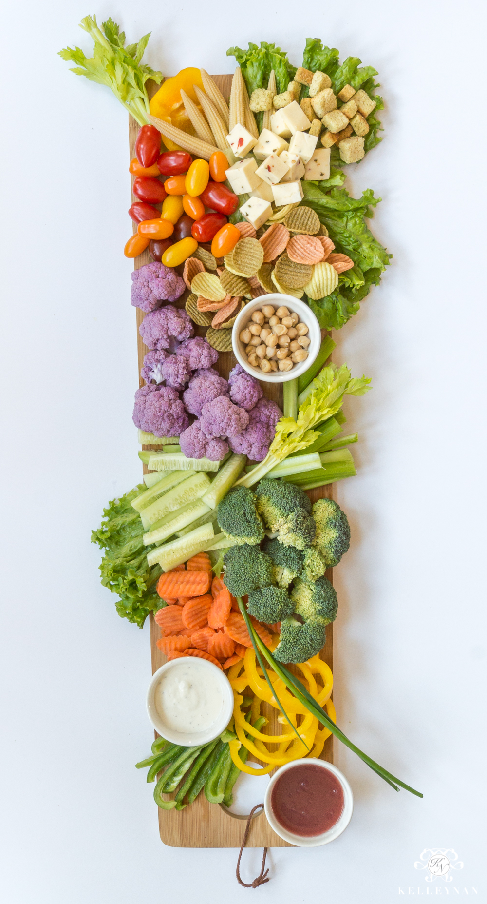 The perfect vegetable tray on a wooden paddle board
