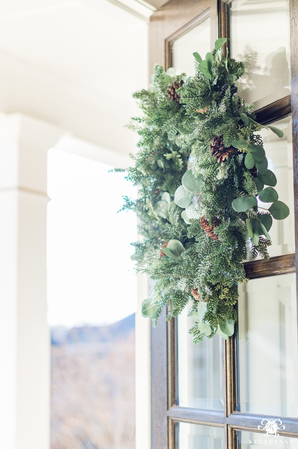 Eucalyptus and green leafy winter wreath to transition after the holidays