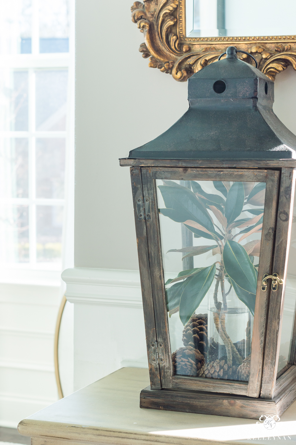 Easy lantern styling ideas with pinecones and magnolia leaves