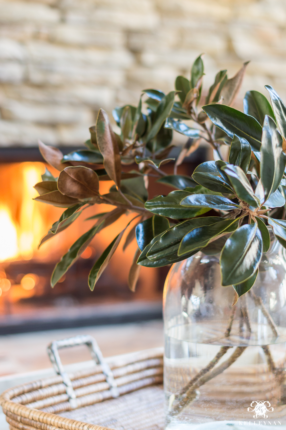 Bunch of magnolia leaves in a clear glass vase