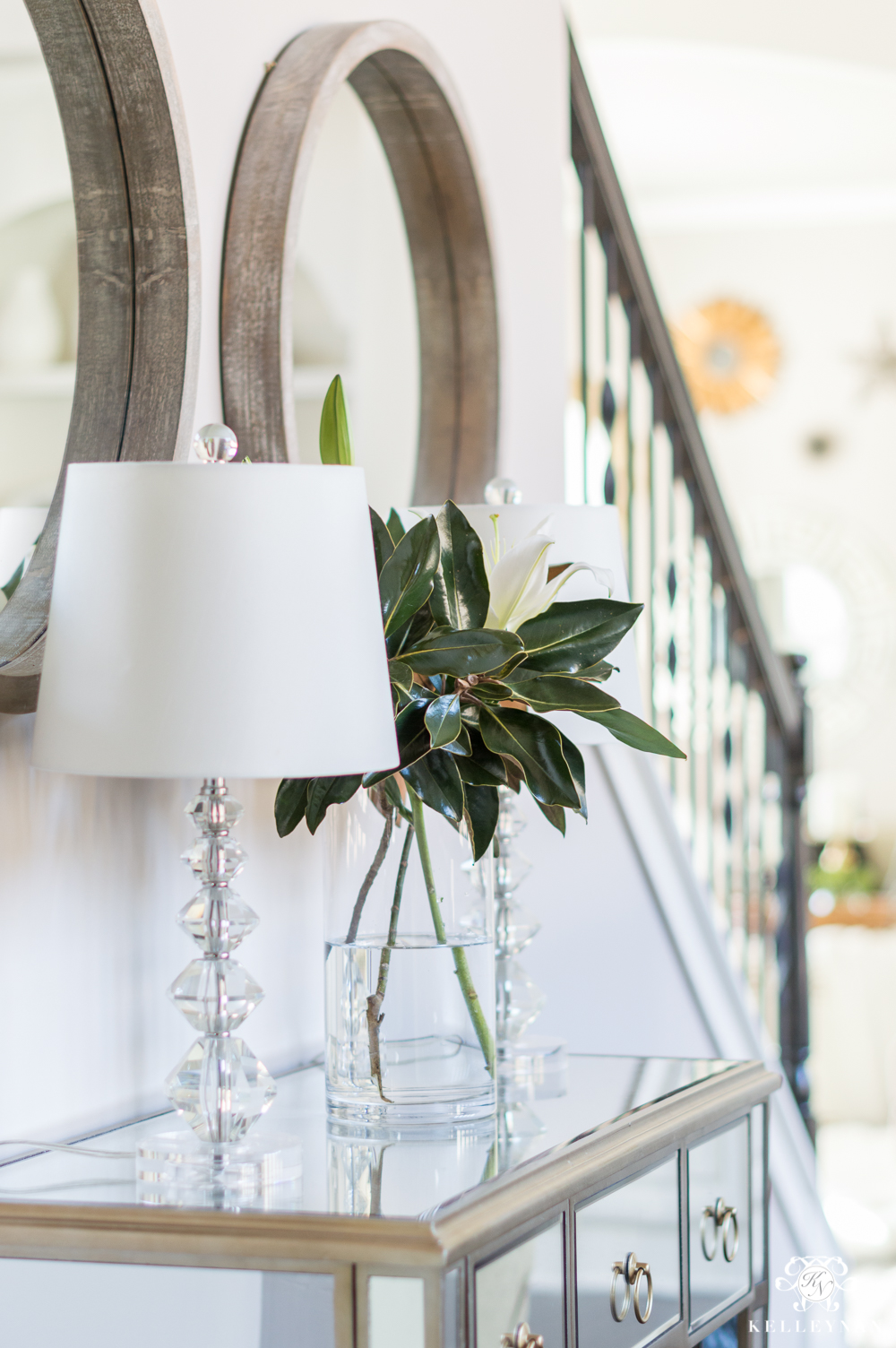 Console table styling ideas with lamps and vases