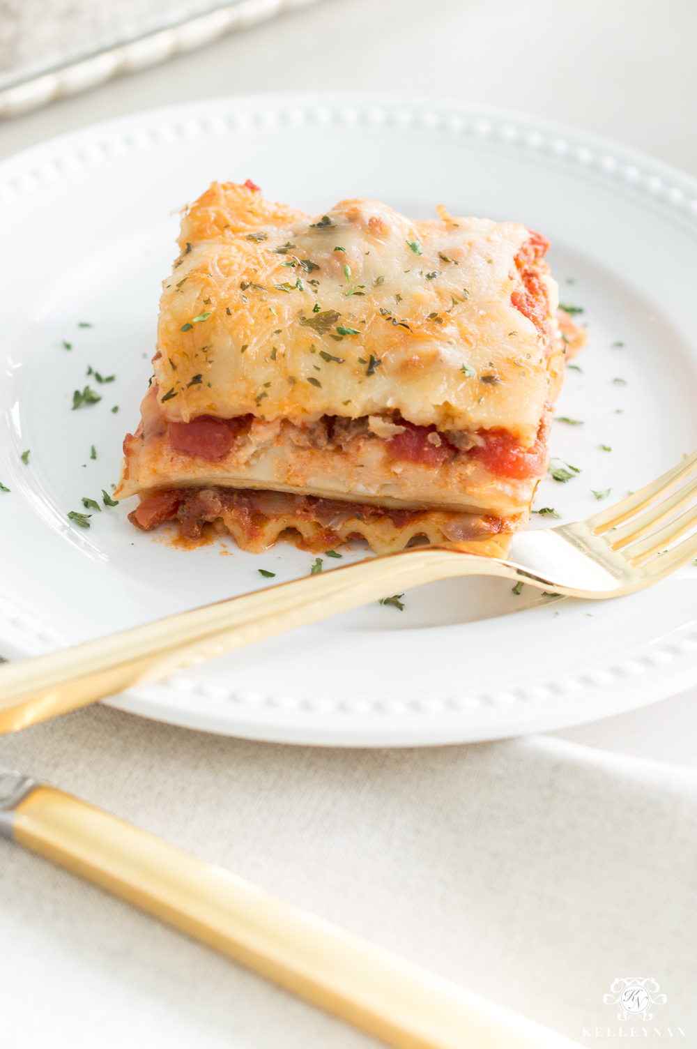 Favorite easy two-layer lasagna recipe with ground beef- a simple Italian favorite!