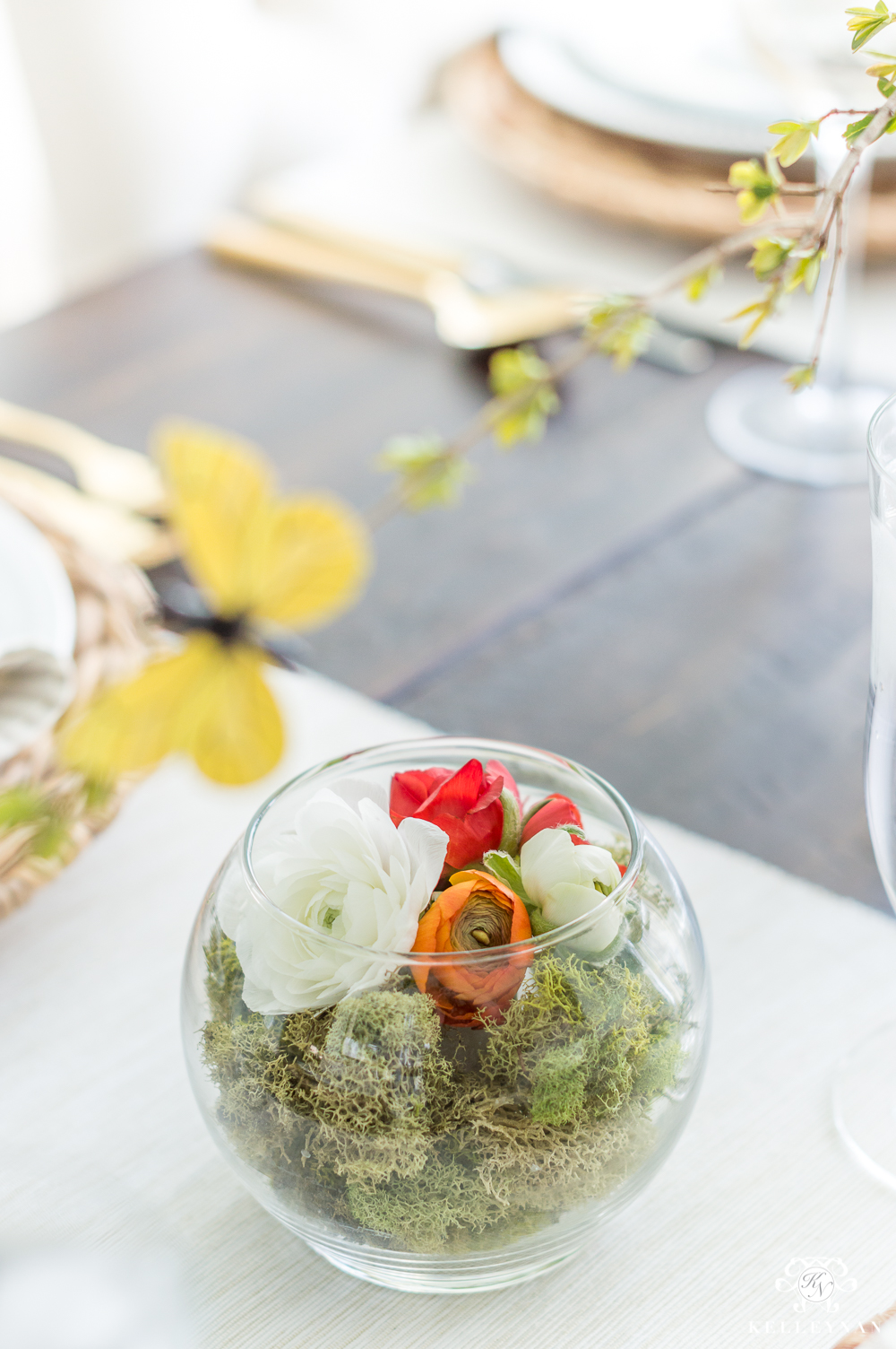 Ranunculus Terrariums on a spring table with moss