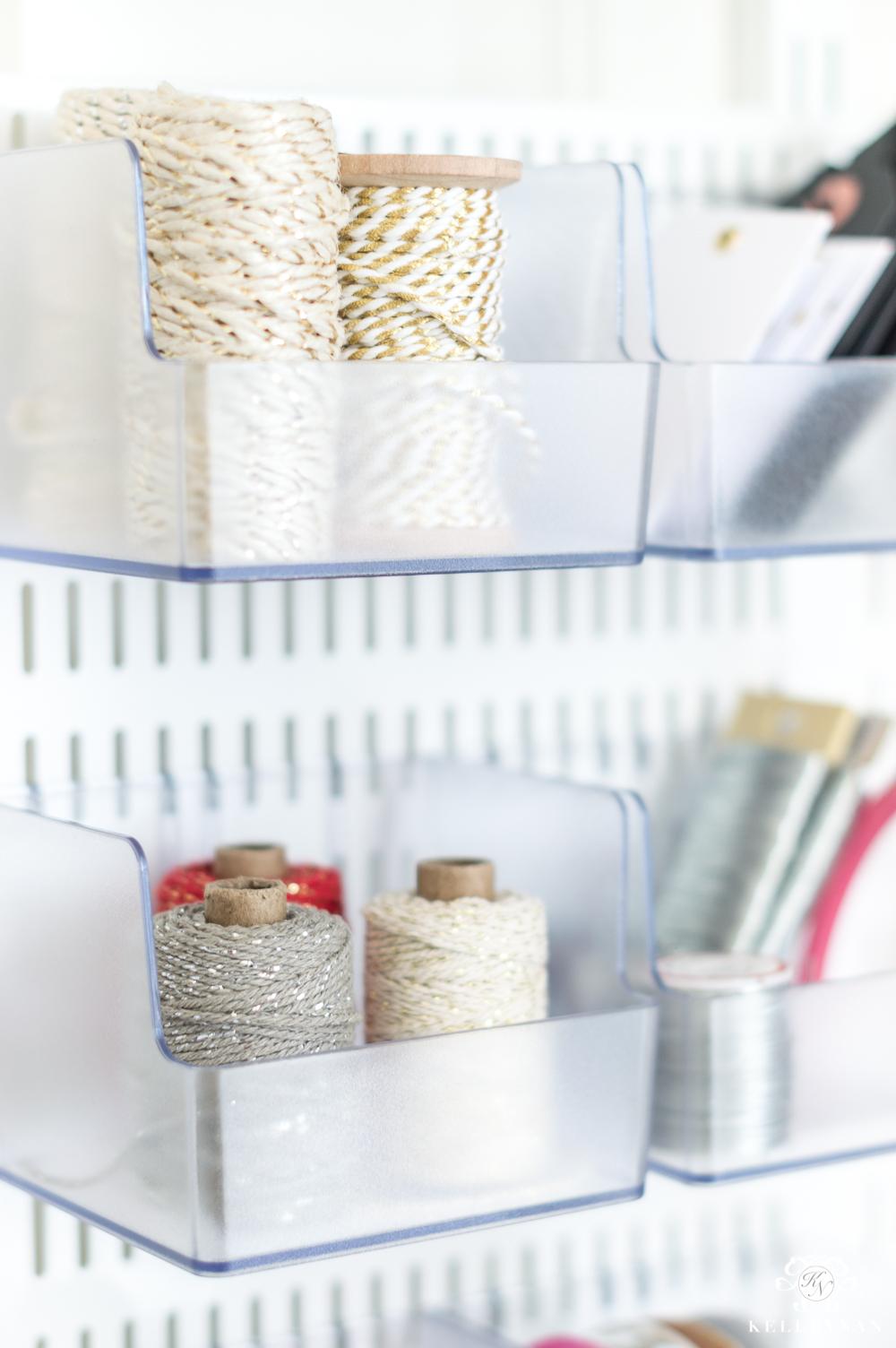 Organized twine and ribbon in the back of the door gift wrap station