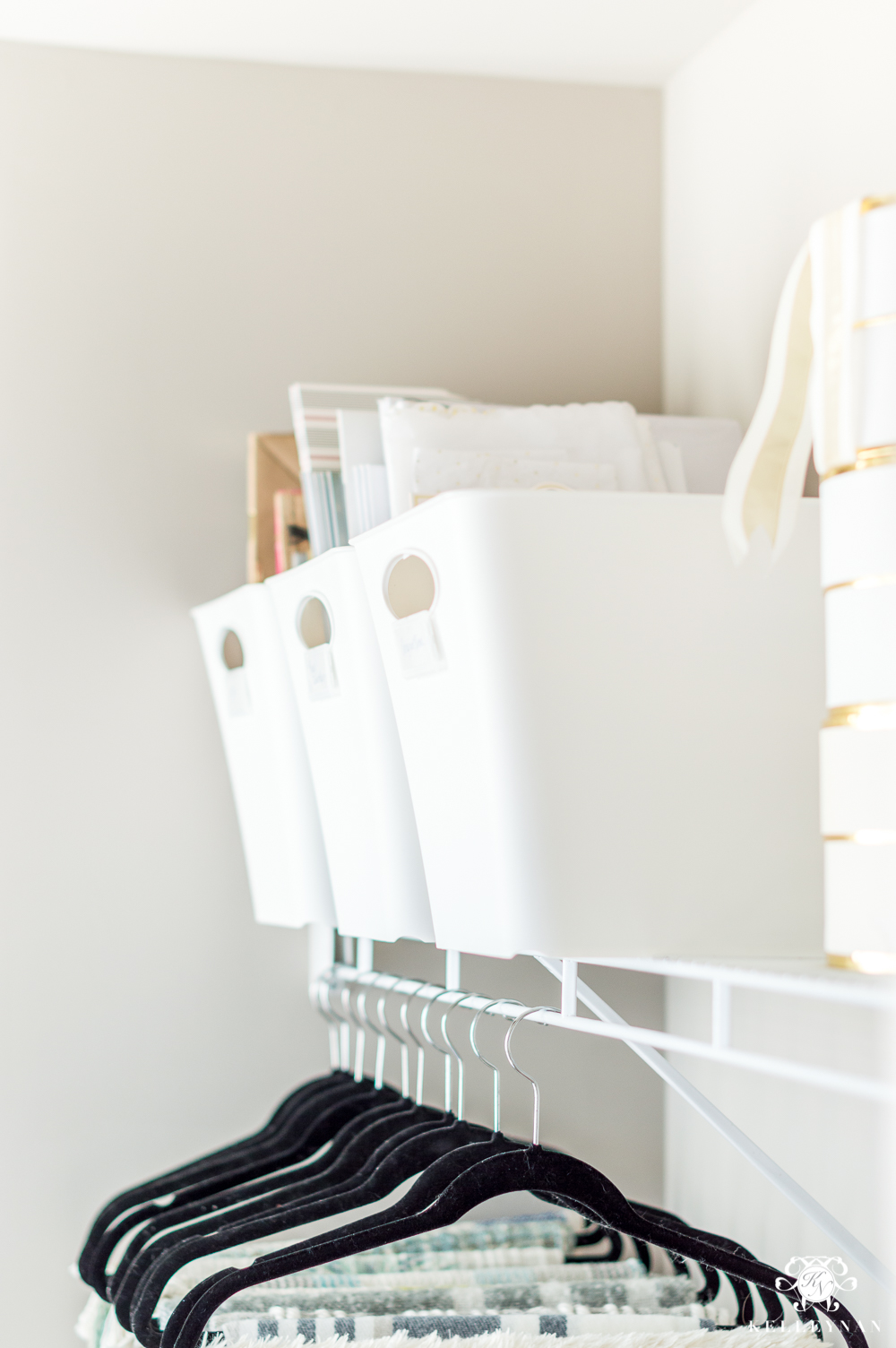 Gift wrap bins and organization in the closet