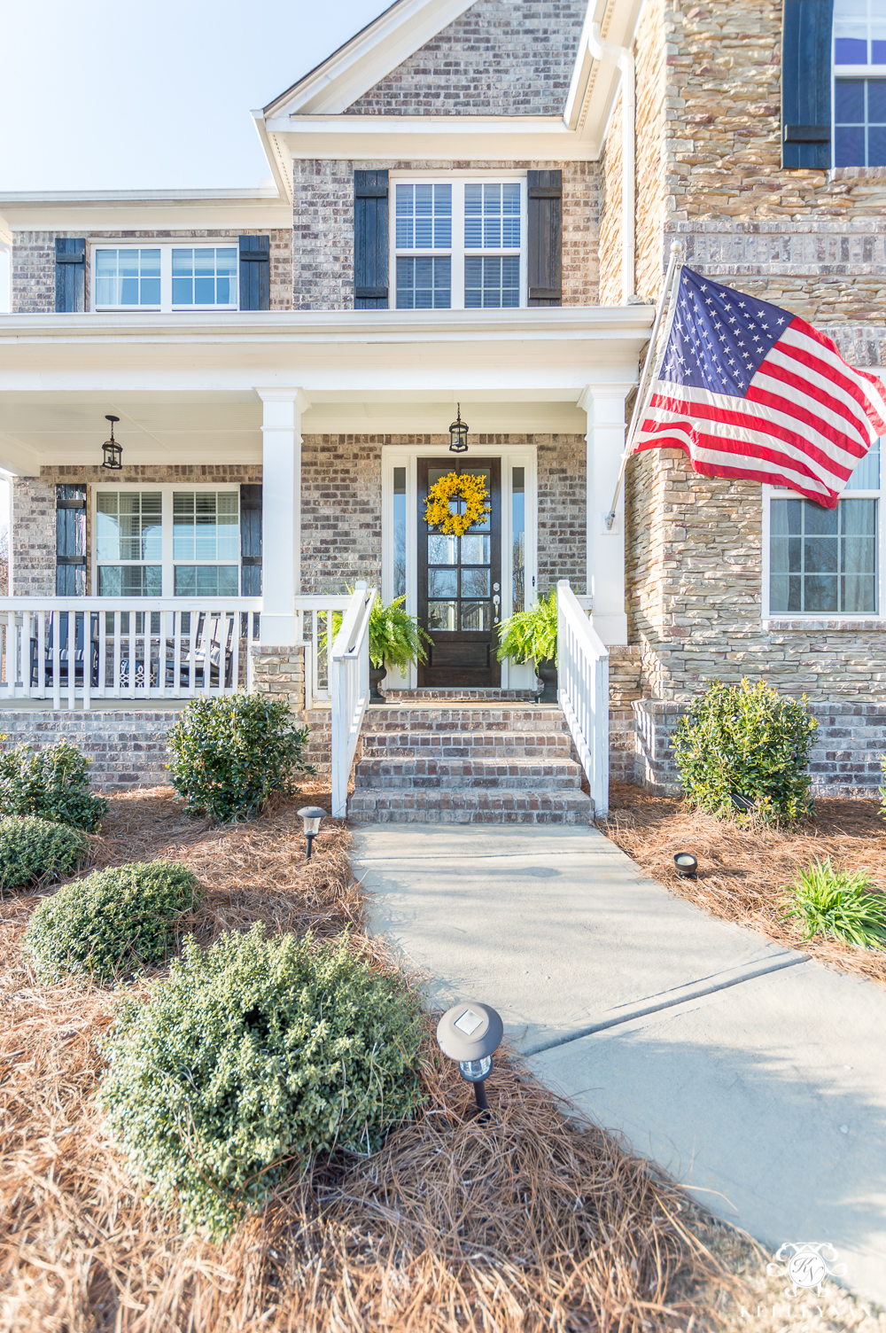 Traditional Craftsman Style Home with American Flag