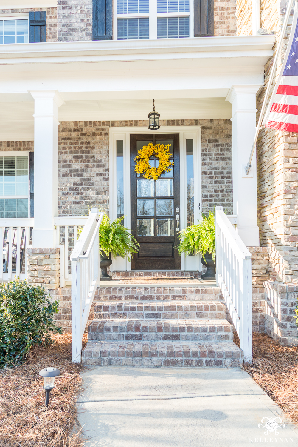 Spring Front Door with Yellow wreath and ferns for spring- front door and porch ideas