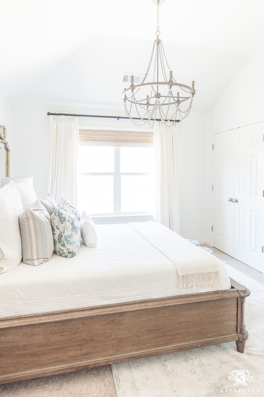 Beaded Chandelier over guest bed for guest bedroom design inspo