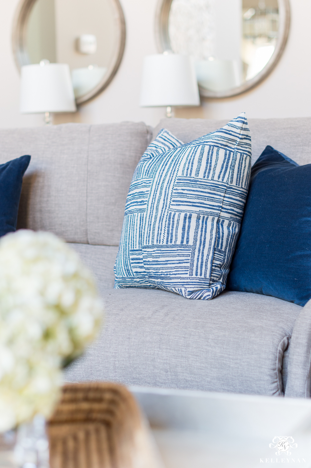Blue and White Pillows on Sectional Sofa