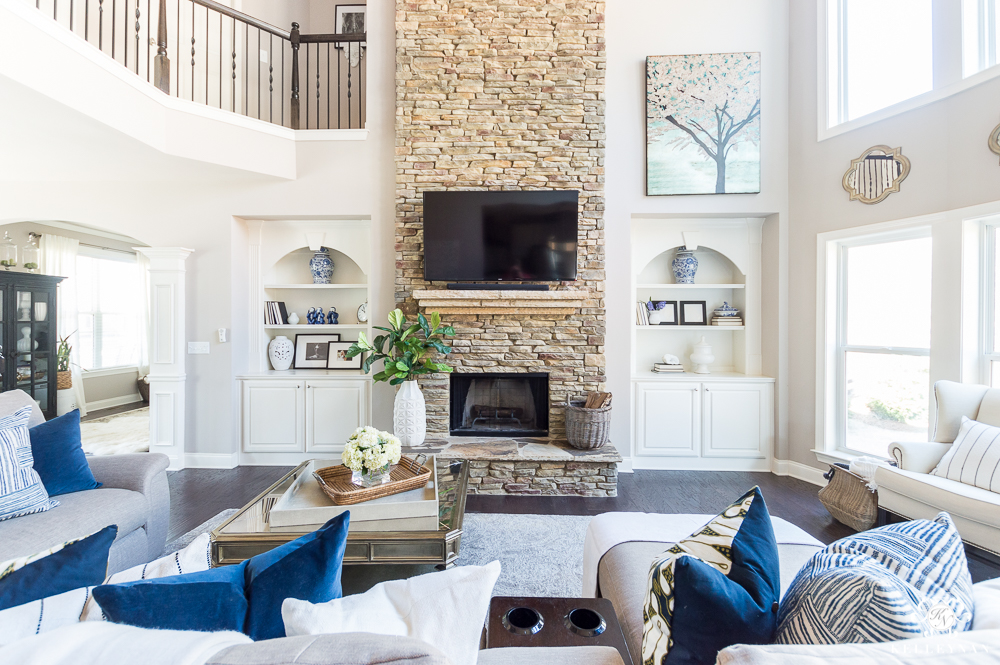 Family Room with Big Stacked Stone Fireplace and Built-Ins Flanking TV over fireplace
