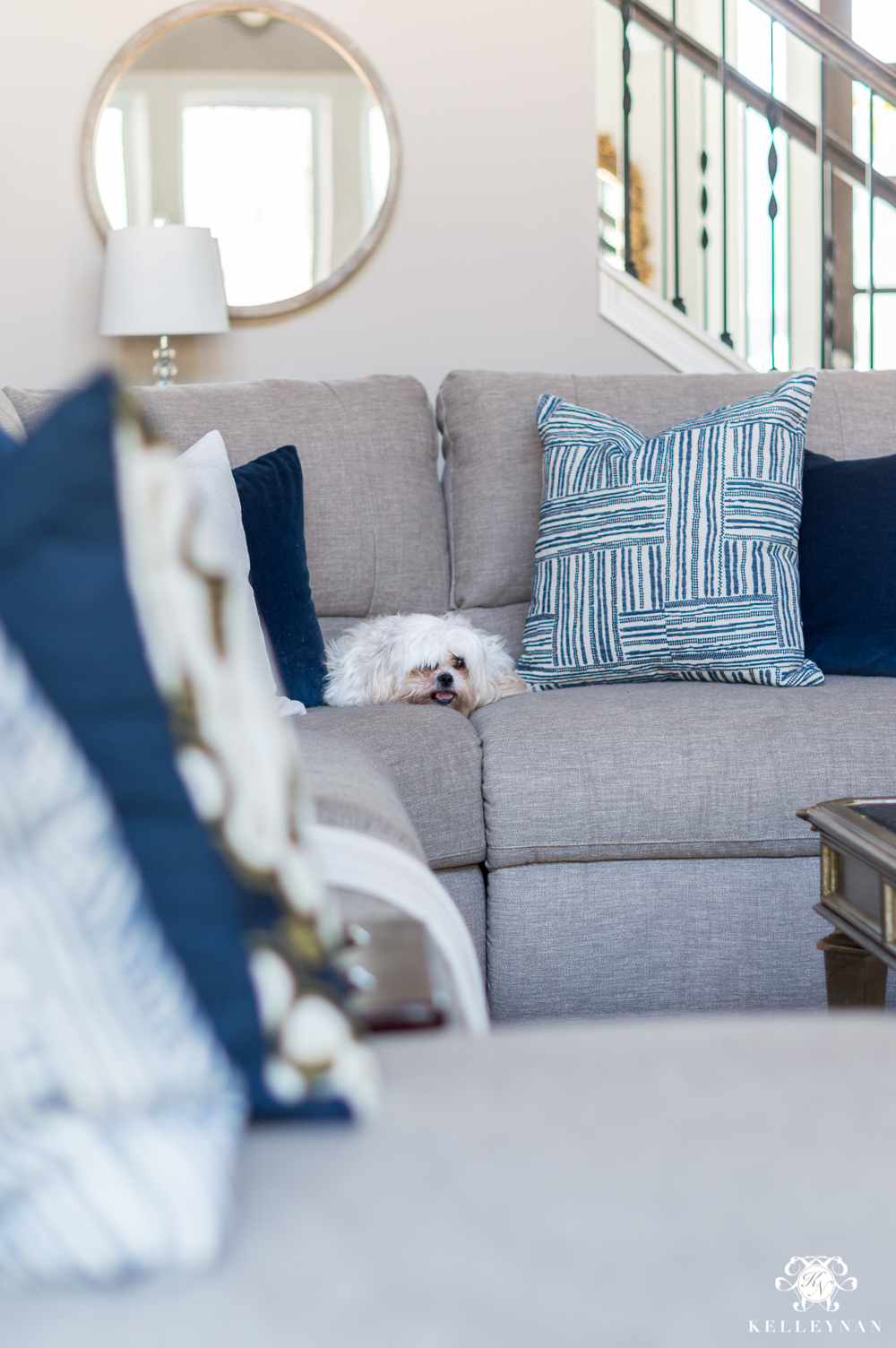 Blue and White Pillows on Sectional for Spring