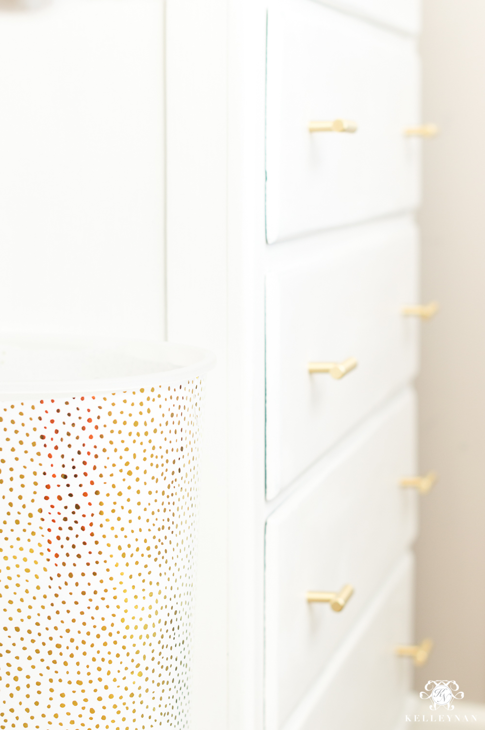 Trash can covered in gift wrap to dress up wallpaper holder