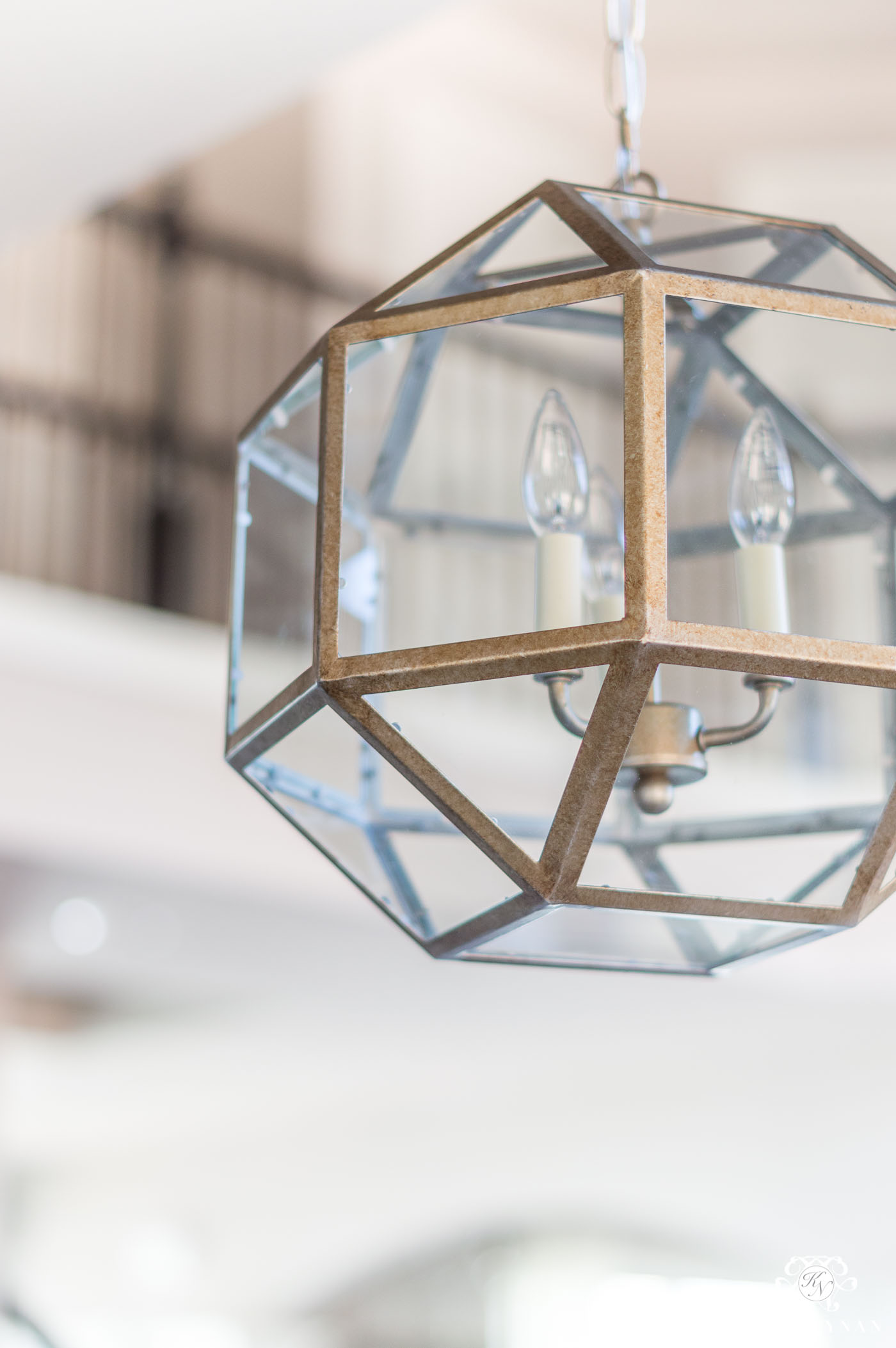 Glass Pendant Lantern Lights Over Kitchen Bar