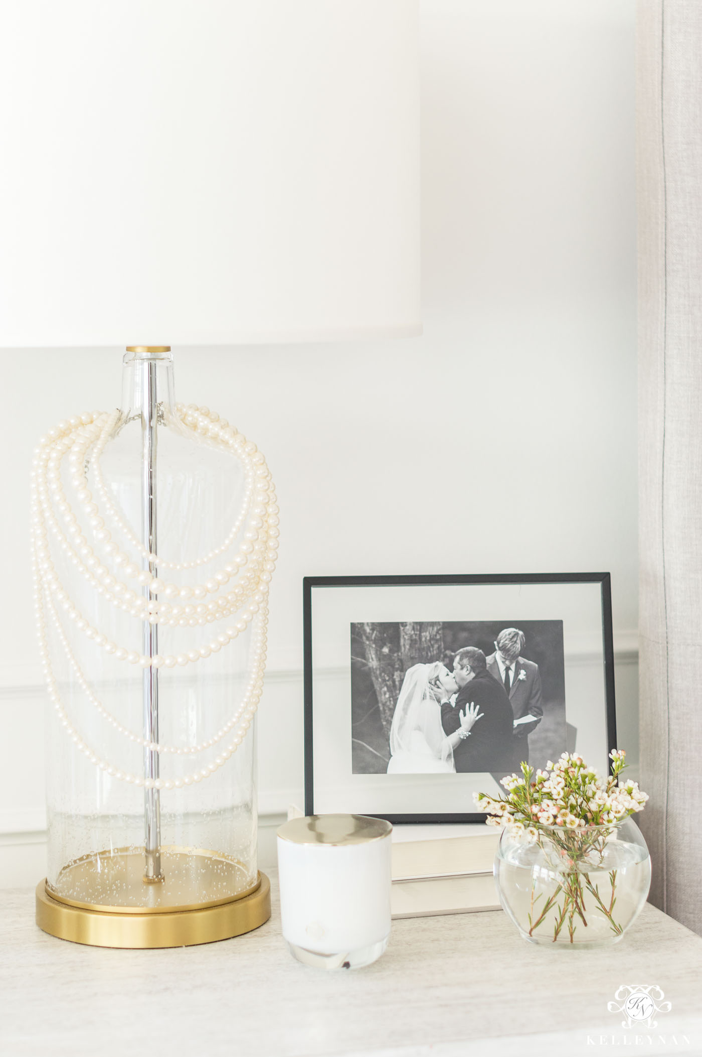 Strands of pearls on a bedside lamp
