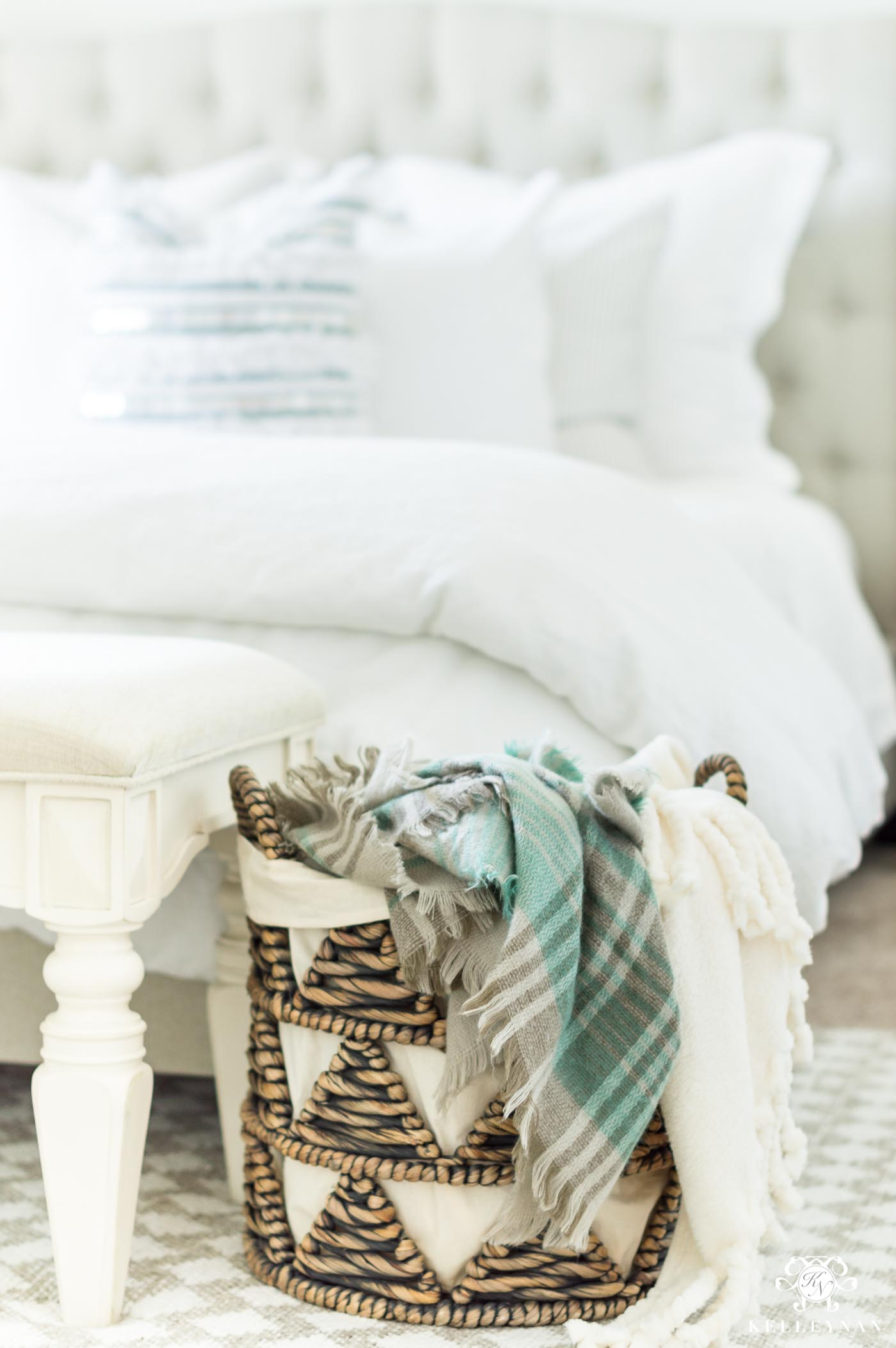 Using a basket for blankets in the bedroom