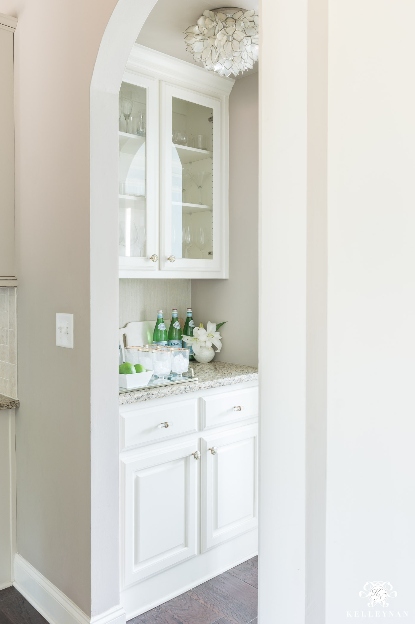 Small butler's pantry makeover with white cabinets and greige paint