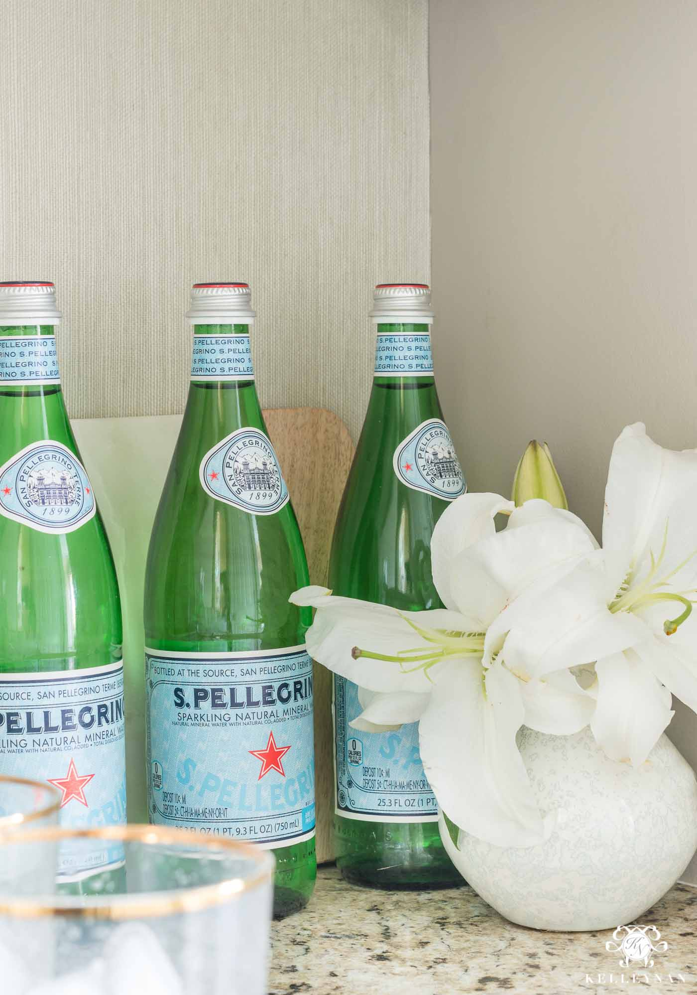 Styling kitchen counters with San Pellegrino and lillies