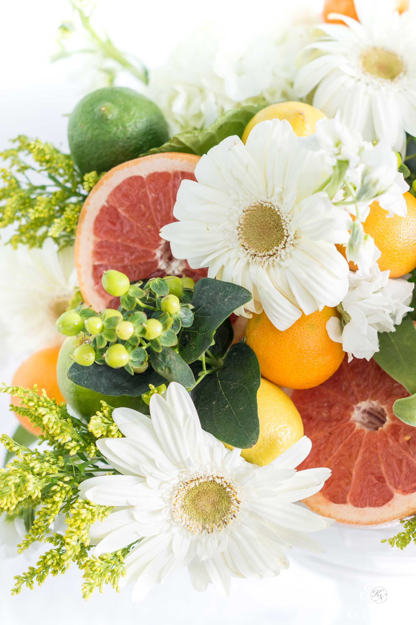 citrus and grapefruit flower arrangement centerpiece