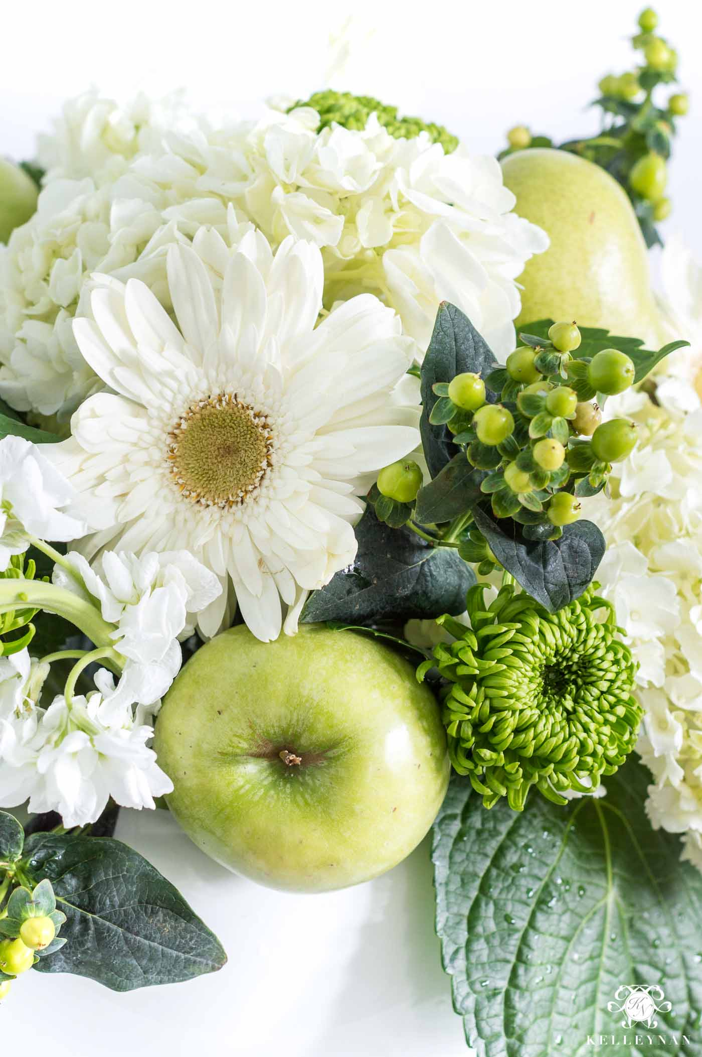 Green and white fruit and floral centerpiece arrangment