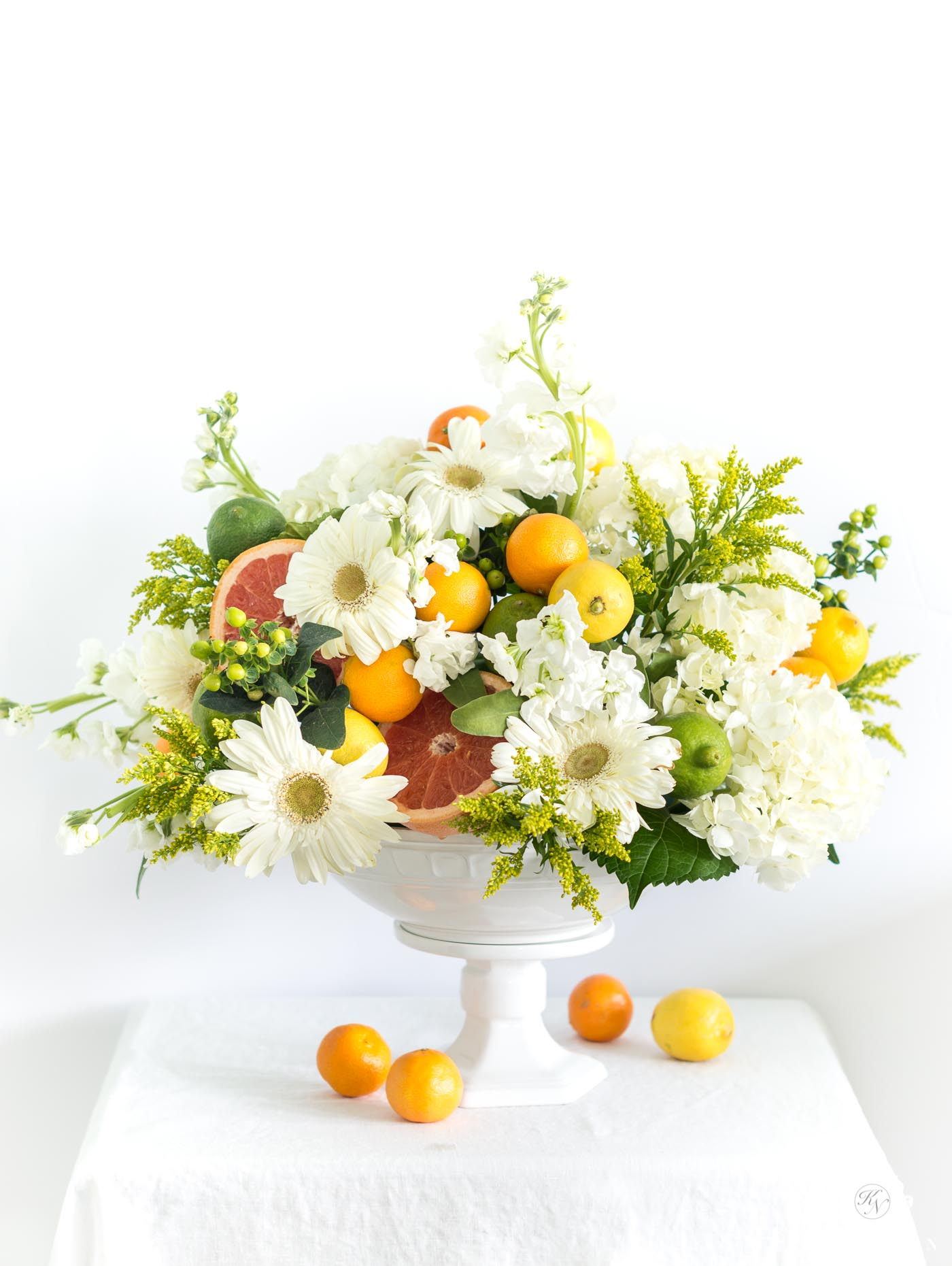 How to create an easy citrus fruit and flower arrangement centerpiece