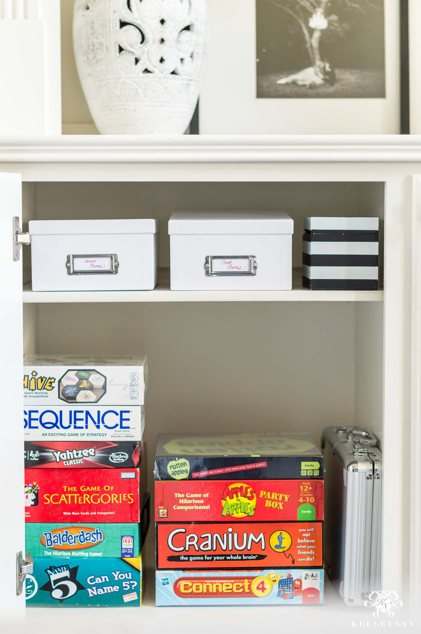 How to organize and declutter board games and playing cards in a hidden cabinet