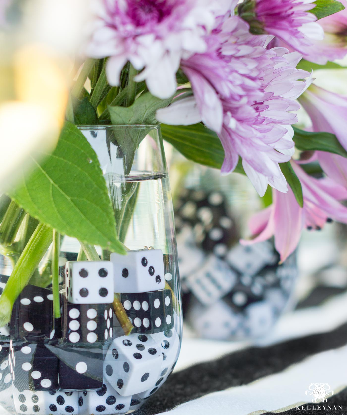 Game night flower centerpiece idea with dice as rocks in the vase