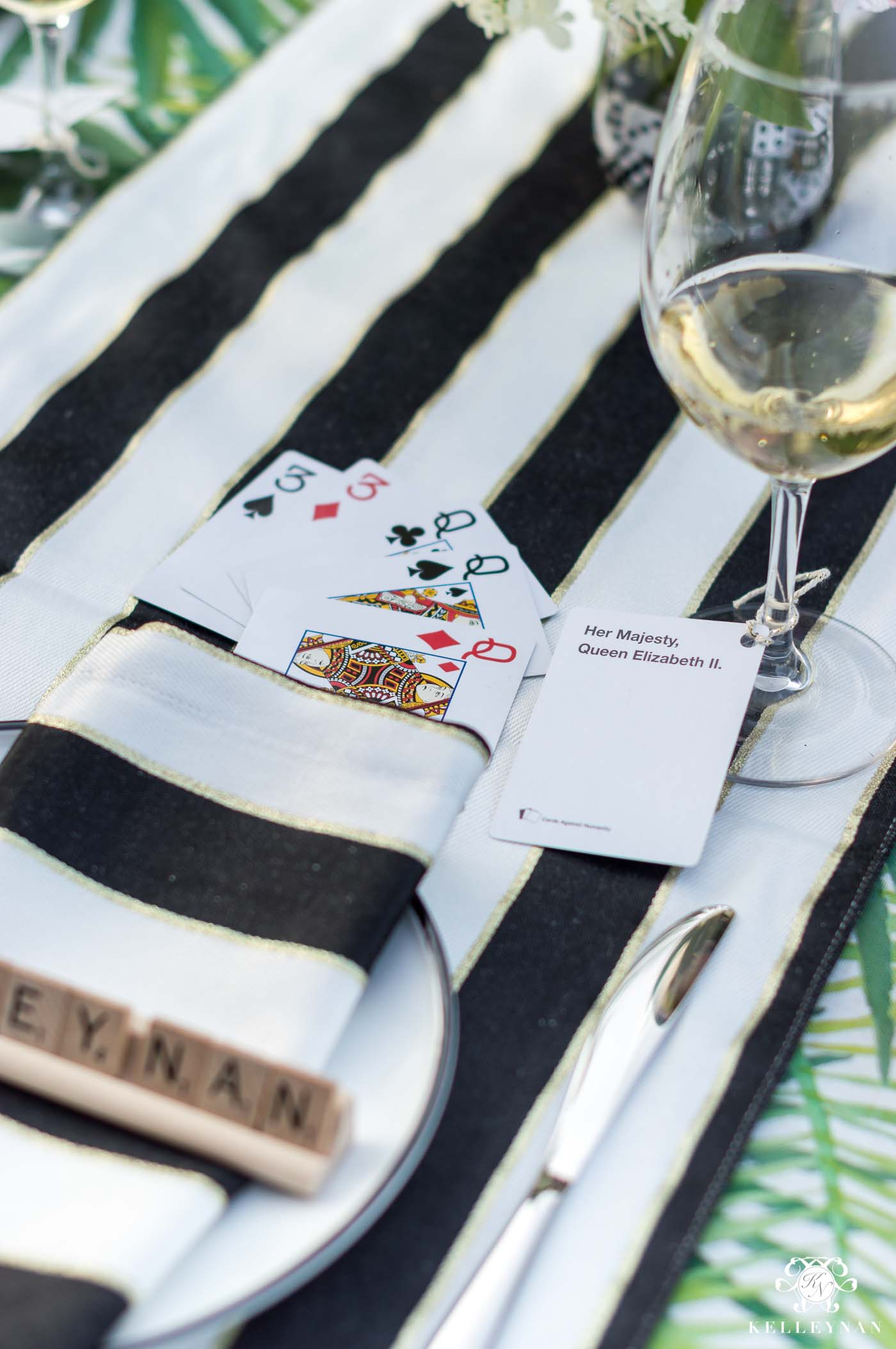 Game night wine charms using cards against humanity people cards