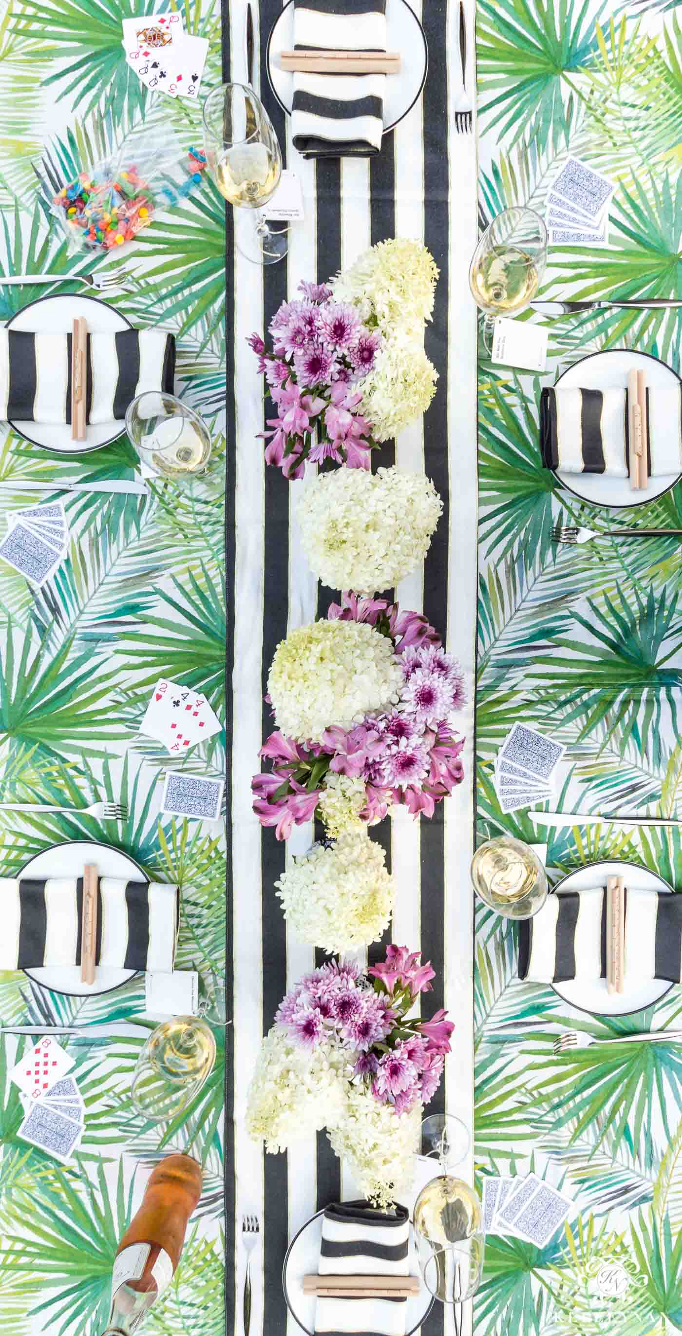 Pretty outdoor palm frond and palmetto leaf table with black and white kate spade napkins and runner for game night