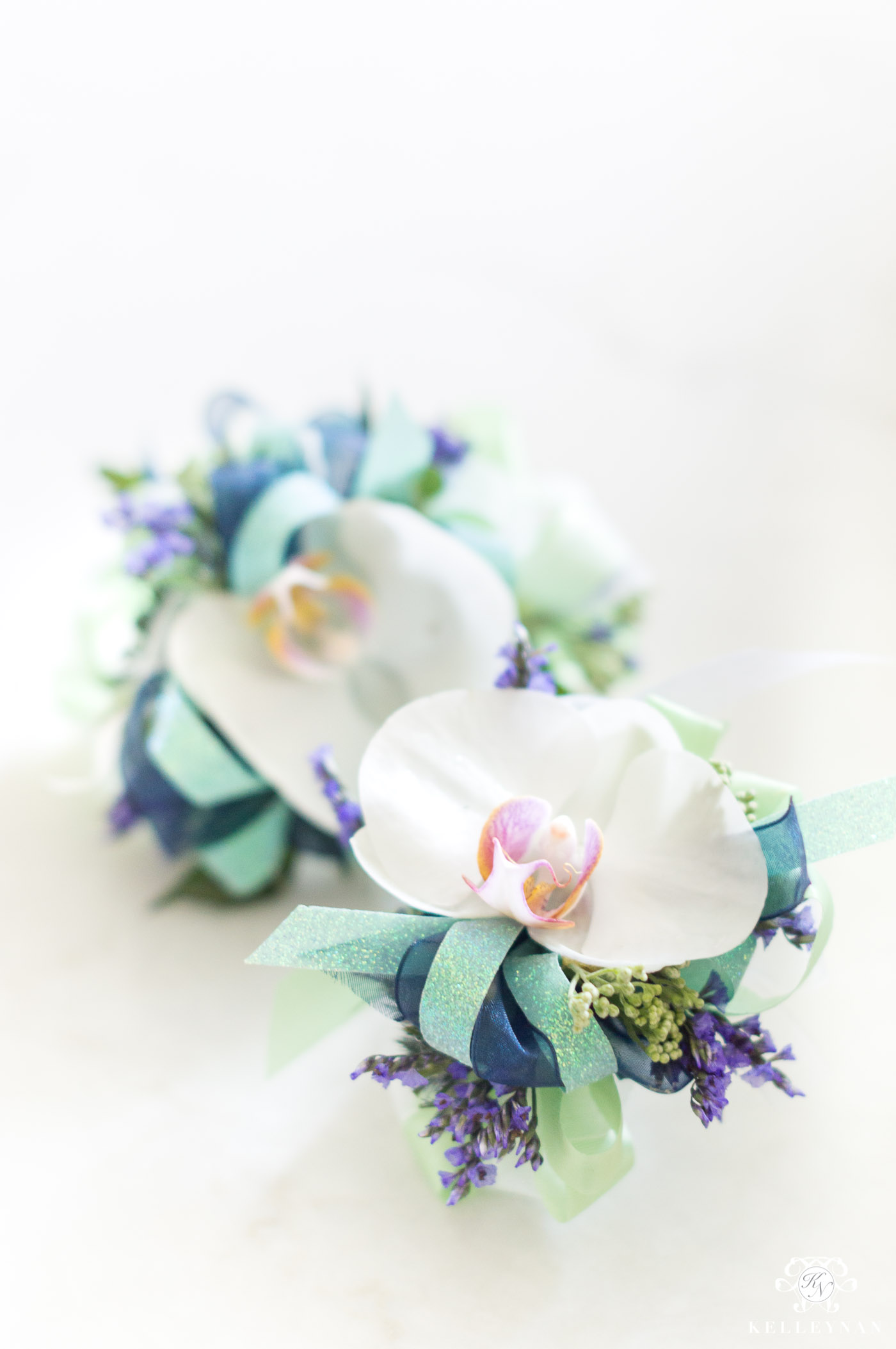 Orchid Corsage with Navy and Mint Green Color Scheme