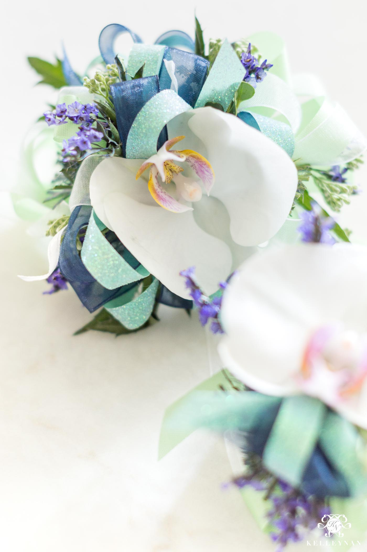 Orchid Corsages for Mom and Sister at Baby Shower